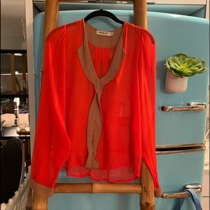 Sheer vibrant orange blouse with tan insets